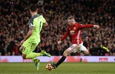 Manchester United's English striker Wayne Rooney has an unsuccessful shot during the English Premier League football match between Manchester United...