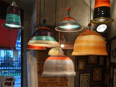 PET bottle lamps by alvara catalan de ocon--Discarded PET (plastic water and soda) bottles made into ceiling lamps by fiber artists.