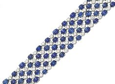 A SAPPHIRE AND DIAMOND BRACELET, BY BULGARI   The highly flexible band designed as a series of cabochon sapphires alternating with brilliant-cut diamond accents, mounted in 18k white gold, 17.5 cm long  Signed Bulgari