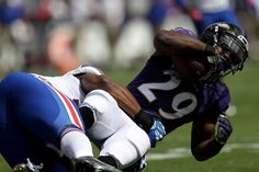 Running back Justin Forsett #29 of the Baltimore Ravens is tackled in the first half during the game at M&T Bank Stadium on Sept. 11, 2016 in Baltimore.