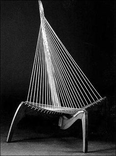 This is a chair made of rope and wood. It was designed by a Danish furniture maker in 1968. The unusual and possibly uncomfortable chair sol...
