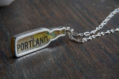 Bottle your favorite beer city in this handmade pendant. Very cool.     Local Craft Beer Pendant by HooticornCrafts on Etsy, $50.00