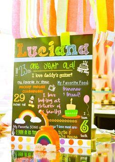 Rainbow themed 1st birthday party, birthday board via etsy.