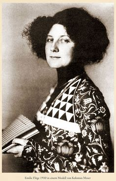 Emilie Flöge, muse of Gustave Klimpt, wearing a model of Koloman Moser, Wiener Werkstätte,1910. Emilie Louise Flöge (born 30 August 1874 in Vienna and died 26 May 1952 in Vienna) was an Austrian designer, fashion designer and businesswoman. She was the life companion of the painter Gustav Klimt. Established her couture salon in 1904. Known for clothing in the style of the Wiener Werkstätte (handpainted and printed silks)
