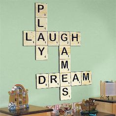 Decor: Love this play on Scrabble! What an awesome way to decorate your son or daughters nursery!