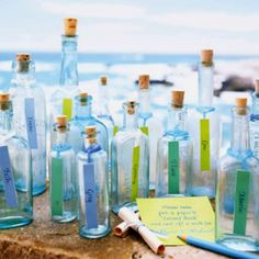 Message in a bottle. #Beach themed #wedding details.   Love this idea - would be great for escort cards, or smaller bottles into a big hurricane glass as a guest book! - @Belle'Ham Wedding & Events