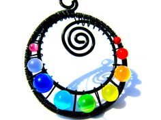Spiral Rainbow Cat's Eye Beads and Beautiful Black Wire, Woven into a Spiral Pendant with a Sleek Black Nylon Choker Cord