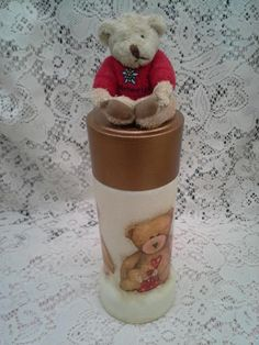 altered coffee jar with teddy bear on top