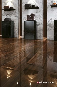 Shiny floors in varnished wood look porcelain tiles evoke the aesthetic effect of the surface of wood resin, for spaces that combine luxury and functionality.   Collection: Etic Pro by atlasconcorde.com  