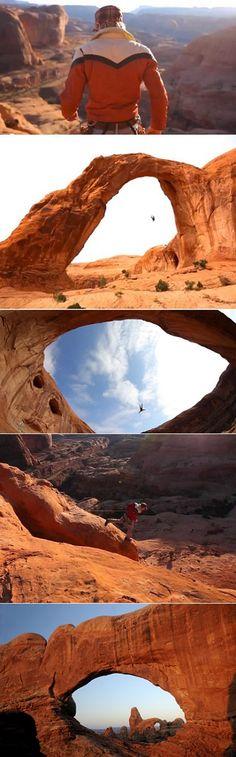Swinging through the beautiful Corona Arch in Moab, Utah.