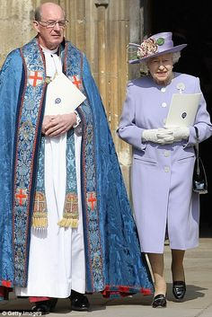 Queen Elizabeth II and the Dean of Windsor David Conner leave the chapel after a thanksgiving service for the Queen Mother and Princess Margaret