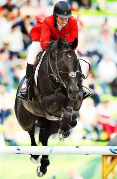 Love Beezie Madden and love Cortes C! How amazing is it that this horse crosses his legs when he jumps?