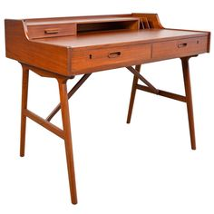 Danish Modern Teak Desk by Arne Wahl Iversen | From a unique collection of antique and modern desks and writing tables at https://www.1stdibs.com/furniture/tables/desks-writing-tables/