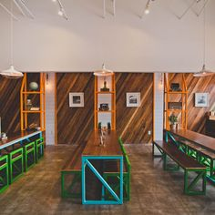 The interiors also take their cue from the menu, with the bright orange associated with many kimchi varieties playing a prominent role in the colour scheme alongside the herby green of cilantro and a vibrant ocean blue...