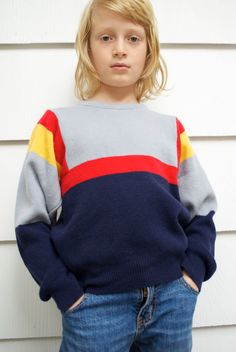 Vintage 1970s child's ski sweater in gray, navy, red, yellow. Awesome mod color block stripes. Looking super dope on the slopes. Size 6-8.
