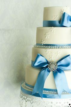 wedding cake with cornflower blue ribbon