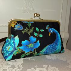These clutches are lovely - birds or chrysanthemums
