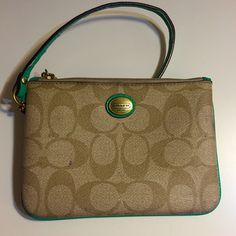 Coach Wristlet. Very cute! This Wristlet is one of my favorites! It is a beautiful color and lightly used. It does have a couple of small ink spots as pictured. Coach Bags Clutches & Wristlets