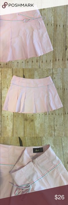 Cute, flirty Hurley skirt Cute, flirty Hurley skirt!   Pink with attached ribbon.  Zipper on the side.  15 inch waist.  13.5 inches long. Hurley Skirts