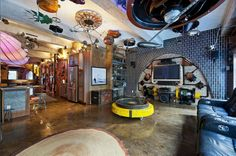 "120 West 29th Street, (FlatIron District) New York NY, $1.75 million retro-futuristic ""steampunk"" fantasy pad. A computer controlled colour-changing zeppelin light feature is prominent in the kitchen. It contains 1,800 square feet of living space and a large attached patio. (The owner) literally found the stuff all over the place and put it together piece-by-piece. She likens the features to many of the things seen on TV's ""American Pickers."""