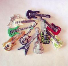 Polymer clay guitar necklaces by XxSierraRose.deviantart.com on @DeviantArt