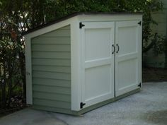 Trash can and recycling shed Have this outside your house great idea