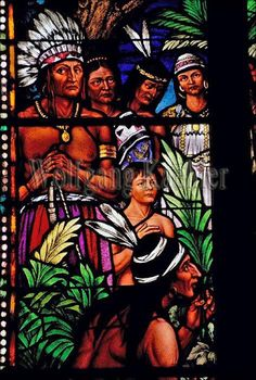 """This church is known widely as the """"Cathedral of the Osage"""". Special permission from the Vatican had to be granted to depict living tribal members in the glorious stained glass that was crafted in Munich, Germany in 1919. The two largest windows show scenes significant to the Osage. One shows Columbus meeting a party of Indians and the other shows prominent Osage of the era gathered around the black cassocked Rev. Schoenmakers. Immaculate Conception Catholic Church, Pawhuska, Oklahoma."""
