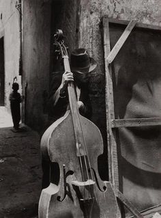 "By Lola Álvarez Bravo ""Man with contrabass"" (notice only 3 strings)"