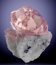 Morganite. A pink diamond and with white clear diamonds around it all on a beautiful engagement ring :)
