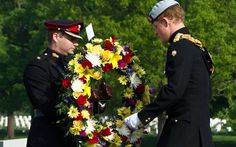 Prince Harry places a wreath in Arlington National Cemetery on May 10, 2013