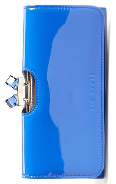 Cute cubic crystals catch and reflect the light on this vibrant blue patent leather Ted Baker wallet. It's so pretty, it could be carried as a chic clutch, too!