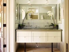 I love this bathroom vanity and the corrugated metal layer.