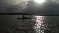 My Photography.  This is an image I captured of a family member kayaking past the Lag Pier, Donegal, Ireland.