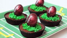 Peanut butter cups topped with icing grass and mini chocolate footballs are the perfect dessert for any game day party.