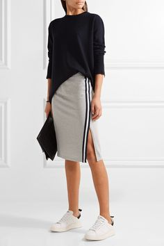 Athleisure (a dictionary-affirmed word, as of 2016) hits a singular sweet spot with the design of this skirt, which could easily find its way to work with the addition of a blazer . . . Women's gray stretch cotton and modal-blend jersey skirt by @Splendid via @netaporter @athleisure #athleisure @FW2017