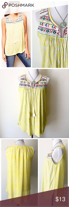 Yellow One September Embroidered Tank Top Adorable tank top! Worn a few times, one of my favorite tank tops. It's loose, breezy, and the perfect color for Spring! A lovely lemon yellow in an Ikat Print, Silk back and Cotton/Rayon front, Tassel ties at the neckline, just overall cute! Size Medium, in good condition - there are some flaws: minor mark on the back and tiny pin hole. Low price reflects this. Anthropologie Tops Tank Tops