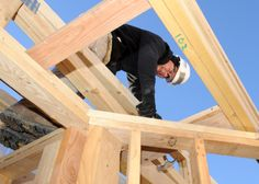 Senior Airman Daniel McElhattan, 460th Space Communication Squadron client systems technician, hammers a nail at the Habitat for Humanity build Jan. 10, 2014, in Aurora, Colo. HFH works with 1,500 partners in the U.S. and more than 70 organizations around the world to provide safe and affordable places for families in need. (U.S. Air Force photo by Senior Airman Marcy Copeland/Released)