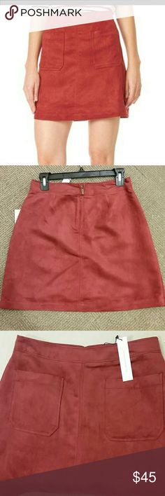 """Faux Suede Skirt Brick red faux suede A-line skirt by Sanctuary.  NWT! Wear this fall with tights and booties!    17"""" long (model is 5'11"""" wearing size small).  Two front pockets, hidden back zipper. Faux suede with polyester lining.  Machine washable. Sanctuary Skirts Mini"""