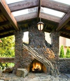 Beyond the front entrance adjoining the den is a generous outdoor room with an organic fireplace built from salvaged clinker brick. Clinker brick is overfired to give it a handmade look.