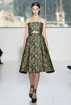 DELPOZO: I love the rich, africana hues and patterns of this fun frock. The bondage-style platforms are the perfect addition to the geometric silhouette of the dress. I love the incorporation of nature and the forest in this piece