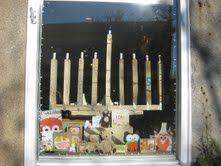 """Roost, winner of """"Most Traditional"""" prize in the Salem MA 2012 Winter Holiday Window Contest."""
