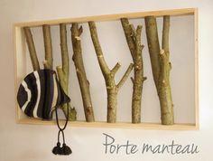 Porte manteau avec des branches d'arbres