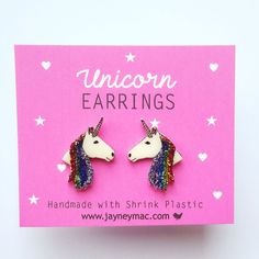 These are unicorn shrink plastic earrings. It unicorns are designed by me. The earrings are completely handmade from start to finish. To make them I print, cut and shrink the them, glitter them and coat with a clear resin glaze. They are approx 20mm x 15mm in size and would make a perfect gift for any unicorn lover.  I also have a brooch to match