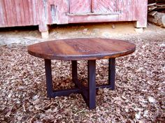 Reclaimed wormy chestnut round coffee table with industrial metal base. $425.00, via Etsy.