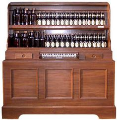 "Beer Bottle Organ    A musical instrument made by Peterson Tuners, yes, the organ sound is actually produced by blowing air over the tops of real beer bottles.    The bottles are filled or ""tuned"" using mineral oil, so it will not evaporate or change tunings during weather changes.    The Bottle Organ concept was first developed in the early 1800's.    The organ as shown is self contained with brass fittings, lighting and is housed in a walnut enclosure on casters.    It includes an air pump con"