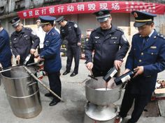 Counterfeiting isn't going unnoticed in China, as this picture shows. Police have been brought in on numerous occasions to destroy products of counterfeiters.