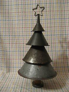 Antique Metal Funnel Christmas Tree with a Vintage Cookie Cutter Star. Visit Check's Antiques for even more ideas!