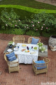 On this patio, a Restoration Hardware table is paired with Malawi chairs by Jeffrey Alan Marks for Palecek.