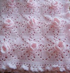 Crochet pattern for beautiful afghan for baby decorated with crocheted roses. Sure to become an heirloom.  Each square is 5.25 inches - adapt to whichever size you require.  This is so gorgeous: Pink Rose Afghan made of Granny Squares, who wouldnt want to crochet this!  Easy simply pattern to follow and would make a stunning blanket for the cot, pram, to wrap baby in, Christening shawl, baby shower gift, a shawl for yourself or friend as a gift.  Make matching Pillows or cushions.  Sports…