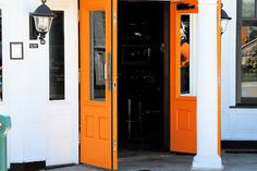 orange doors....love them!!! So colorful and welcoming!